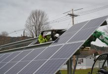 Communities powered by solar workers install panels