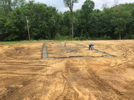 Bozz's Excavating Brandon Boswell preparing a site