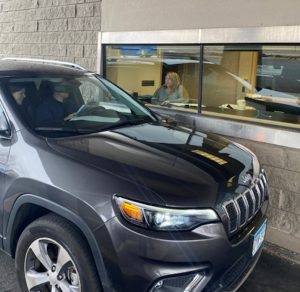 Drive-thru closing car at teller window